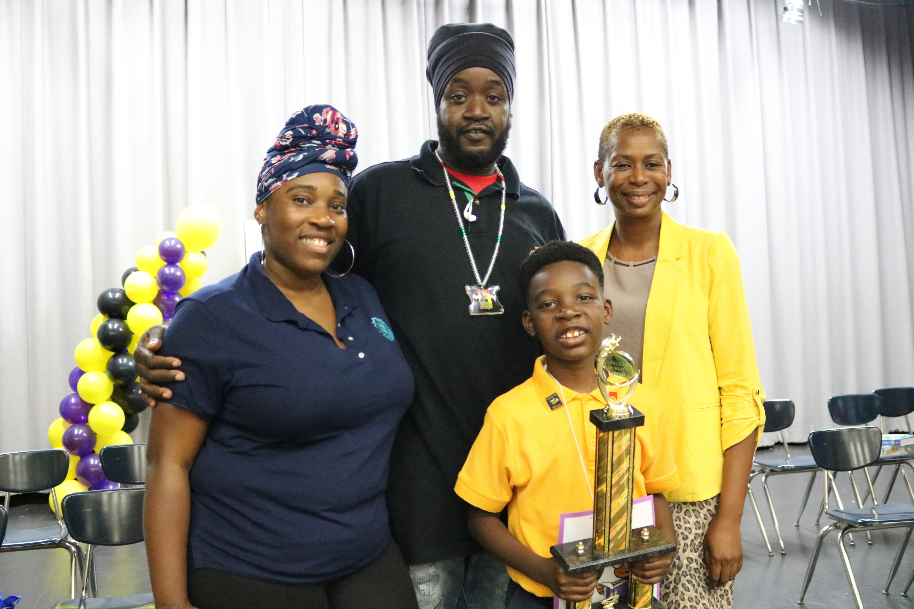 Cairo Leonard with parents and coach.JPG