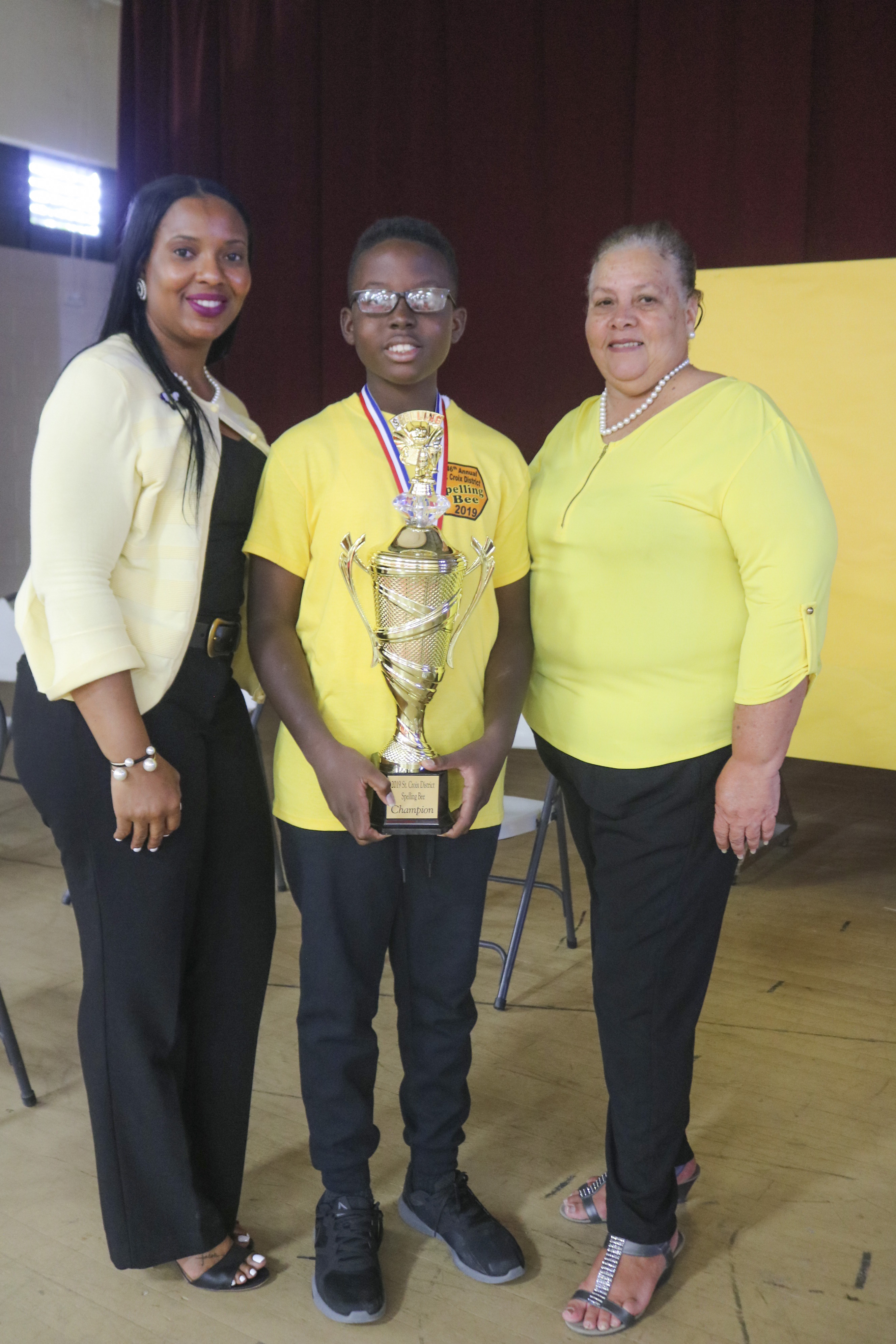 STX District Acting Deputy Superintendent Dr. Carla Bastian; STX District Spelling Bee Winner Michael Atwell and STX District Acting Insular Superintendent Maria Encarnacion.jpg