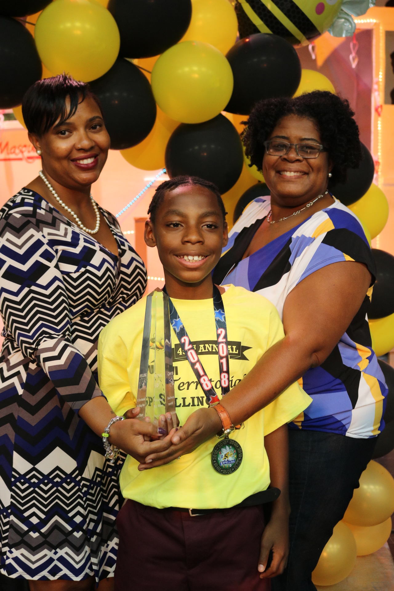 Dr. Carla Bastian, English Language Arts Coordinator, STX District, winner Jah'Quane Graham, 6th grade, Juanita Gardine and Janice Ferdinand, coach.jpeg