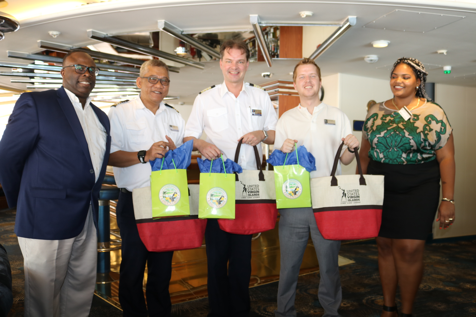 Education and Tourism Officials gifts Prinsendam Crew tokens of appreciation.jpeg