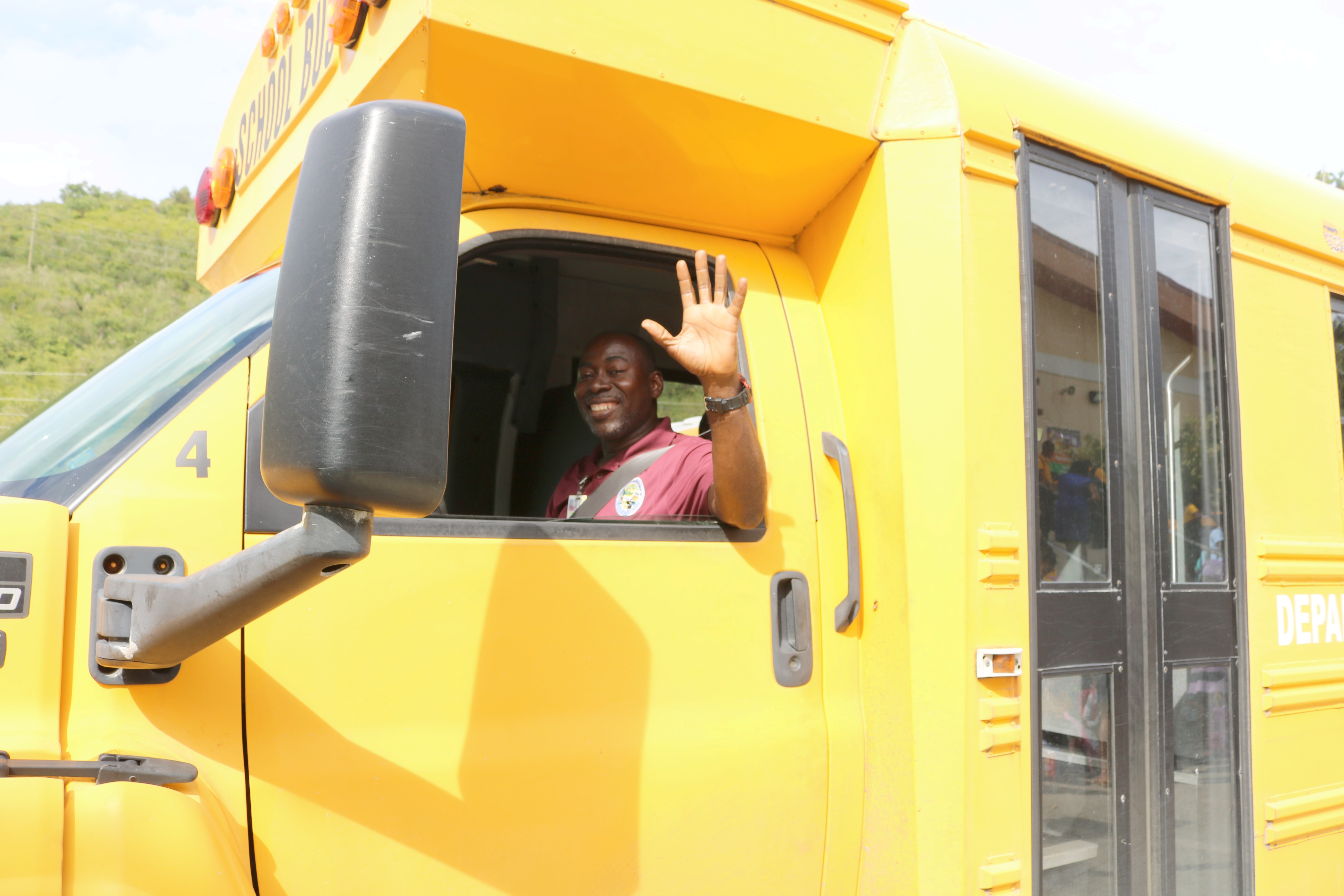 Anthony Jolly School Bus Drives awaits students.jpg